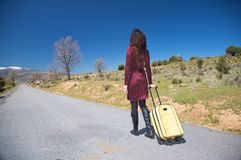 Traveller woman on the road Stock Photography