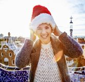 Traveller woman in Santa hat at Guell Park having fun time Royalty Free Stock Photos