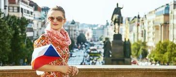Traveller woman on Vaclavske namesti in Prague with Czech flag Stock Photography