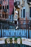 Traveller woman in Venice, Italy in winter enjoying promenade Stock Photography