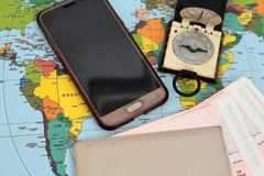 Traveller& x27;s accessories on world map background, top view. Royalty Free Stock Images