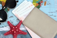 Traveller& x27;s accessories on world map background, top view. Travel planning concept Royalty Free Stock Photos