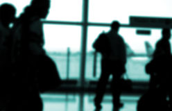 Travellers. Business people rushing at an airport Royalty Free Stock Image