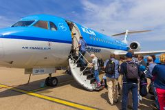 Travellers boarding an Air France KLM Cityhopper Royalty Free Stock Image