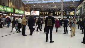 Travellers at Charing Cross railway station stock footage