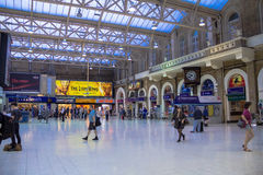 Travellers at Charing Cross railway station. London. UK Stock Images