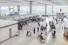 Travellers at the check-in counters of an airport Stock Photography