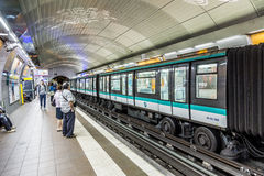 Travellers and commuters waiting at subway station Mairie de Mon Stock Images