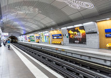 Travellers and commuters waiting at subway station Mairie de Mon Stock Image