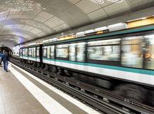 Travellers and commuters waiting at subway station Mairie de Mon Royalty Free Stock Photos