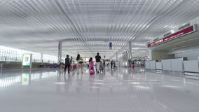 Travellers in the departure hall of Hong Kong International Airport. stock footage