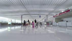 Travellers in the departure hall of Hong Kong International Airport. Hong Kong, China - June 23, 2015: Travellers in the departure hall of Hong Kong stock footage