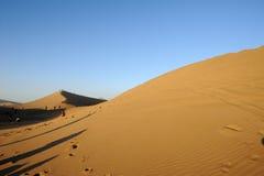 Travellers in the desert Stock Photo