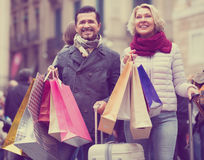 Travellers enjoying shopping tour. Couple of travellers enjoying shopping tour outdoors Stock Photos