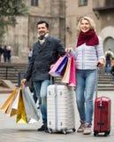 Travellers enjoying shopping tour. Couple of travellers enjoying shopping tour during voyage Stock Images