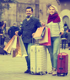 Travellers enjoying shopping tour. Happy mature couple of travellers enjoying shopping tour during voyage Royalty Free Stock Photo
