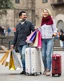 Travellers enjoying shopping tour. Happy mature couple of travellers enjoying shopping tour during voyage in november Royalty Free Stock Images
