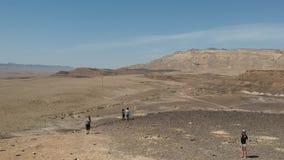 Travellers hike in Israel. Establish shot clip stock video footage