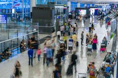 Travellers in the Kong Kong International Airport Royalty Free Stock Images