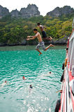 Travellers leap from the deck into the sea. Royalty Free Stock Photo