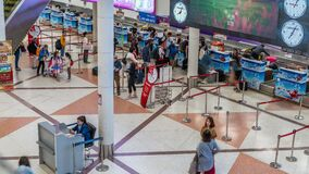 Travellers line up to check in for their flights at Chiang Mai International Airport