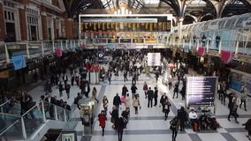 Travellers at Liverpool Street Station. LONDON, UK - SEPTEMBER 28, 2015: Travellers at Liverpool Street Station stock footage