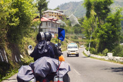 Travellers on motorbike riding long distance on high altitude mountainous road of Himachal Pradesh. Road riders on a highway with backpack on their motorcycle Stock Images