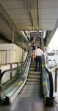 Travellers pass through a BTS Skytrain station. BANGKOK, THAILAND - JAN 4, 2015: Unidentified rail travellers pass through a BTS Skytrain station during rush Stock Photo
