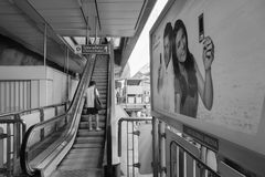 Travellers pass through a BTS Skytrain station. BANGKOK, THAILAND - JAN 4, 2015: Unidentified rail travellers pass through a BTS Skytrain station during rush Royalty Free Stock Images