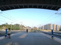 Travellers pending CRH arriving on  Pingshan Railway Station Stock Photo