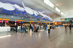 Travellers queued up at the check in counter Royalty Free Stock Image