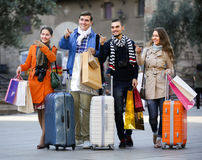 Travellers with shopping bags on street Royalty Free Stock Photos