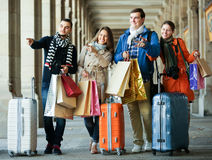 Travellers with shopping bags on street Royalty Free Stock Photography