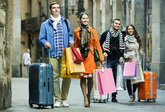Travellers with shopping bags on street Stock Image