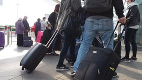 Travellers at Stansted coach station. STANSTED, UK - SEPTEMBER 24, 2015: Travellers at Stansted Airport coach station stock video