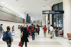 Travellers stroll through the main concourse of the passenger te Stock Photos