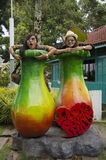 Travellers thai women take photo with sculpture flower Royalty Free Stock Image