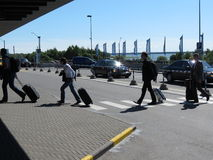 Travellers with their luggage at the airport Royalty Free Stock Photos
