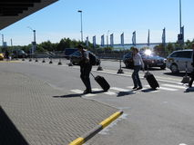 Travellers with their luggage at the airport Royalty Free Stock Image