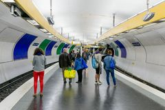 Travellers waiting at subway station Place d'Italy in Paris, France Stock Image