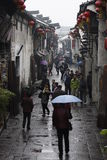 The travellers walking  along Yuehe street in the rain Stock Image