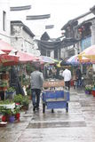 The travellers walking  along Yuehe street in the rain Stock Photography