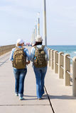Travellers walking pier Stock Photo