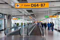 Travellers walking to the gate at Schiphol Airport, The Netherlands Royalty Free Stock Images