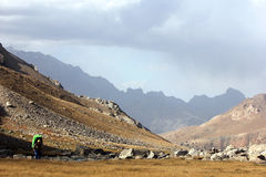 Travellier. Tourist travels on mountain in central asia Royalty Free Stock Image