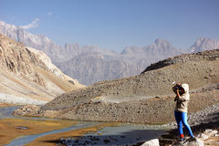 Travellier. Takes pictures beautiful mountain landscape Royalty Free Stock Photo