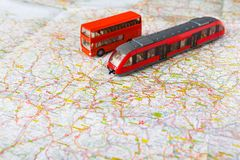 Travelling abroad background. Bus and train on the map. Travelling abroad background. Red doubbledecker and train on the map. Tourism, vacation and business trip Stock Image
