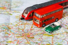 Travelling abroad background. Bus, train and car on the map. Travelling abroad background. Red doubbledecker, train and car on the map. Tourism, vacation and Stock Photos