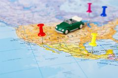 Travelling abroad by car background. Travelling abroad by car concept. Visited countries tackled with pins on the map. Focus on usa. Tourism and vacation stock images