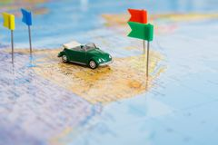 Travelling abroad by car background. Travelling abroad by car concept. Visited countries tackled with flag-pin on the map. Tourism and vacation background Royalty Free Stock Images